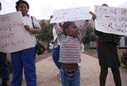 Davia Cole, 6, participates in a protest by DISD support staff. Her grandmother is a school cafeteria worker.
