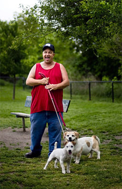 At the small-dog park, Mitchell Chandler shares a laugh with his pets, Rowdy and Stumpy.