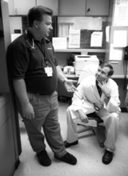 Dr. Ray Swienton shares a story with faculty member Dr. Dale Simmons at UT Southwestern.