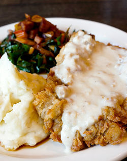 Chicken-fried steak, mashed potatoes and greens -- tourists don&#039;t deserve food this good.