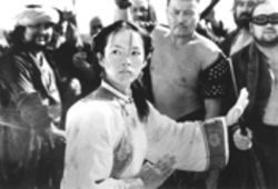 Zhang Ziyi prepares to cook these hard-working men a fine meal, as a woman should. OW! She's chopping me! It was a joke! Help...