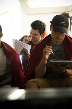 In the Kalita Humphreys Theater lobby, actor Joshua Doss (left) and other cast members look over lyrics on the first day of rehearsals for The Who's Tommy.