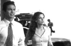 Benjamin Bratt's tie competes for your attention with Sandra Bullock's button-busting shirt in Miss Congeniality.