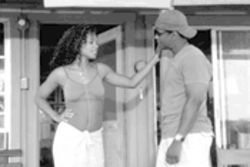 Ann Merai (Sanaa Lathan) flirts with Matt (Denzel Washington) in the implausible but fun thriller Out of Time.