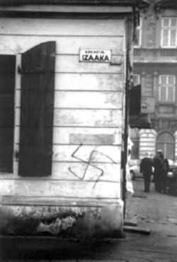 "Jeffrey Gusky's ""Swastika Graffiti on Izaaka Street in the Former Jewish Quarter, Cracow, Poland"""