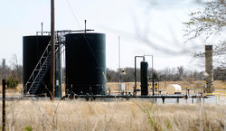A natural-gas well, like this one in Weatherford, would have gone up 1,200 feet from the home of Southlake mom Kim Davis. Chesapeake Energy claims regulation championed by Davis kept the company out of the suburb.