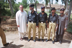 Vokey's work has taken him to Afghanistan and Pakistan, where he posed with members of the local police force.