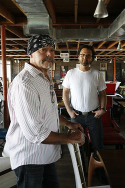 Rick Orr, the king of the pickers, with RED Modern Furniture owner Jonathan Wayne (left). Orr has made a career out of finding undervalued works of art and reselling them to guys like Wayne, though the Internet and a down economy has put a huge dent in the trade.