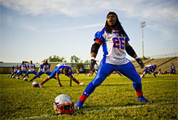 Running back Darshawn Perkins (25) leads pre-game warm-ups in Beaumont. He played college ball at North Dakota State.