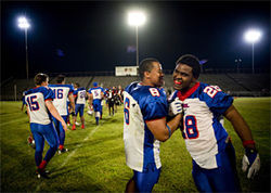Defensive back Thomas Ford (6) and running back Antonio Evans (28) celebrate a 43-12 win over the Demons in Beaumont.