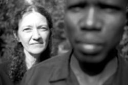 Susan Clark, editor of Echoes of the Lost Boys of Sudan comic, with Gabriel Akol. Clark says retelling the lost boys' story was traumatic.