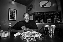 Brian Wright, owner of Crustaceans, with a selection of salty, sorta-Cajun fare
