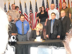 Governor Jan Brewer signing Senate Bill 1070.