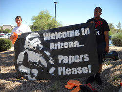 Anti–SB 1070 protesters sum up the situation in Arizona.