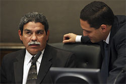 The story from superintendent of schools Michael Hinojosa, shown here whispering with board member Edwin Flores, was that the district's hands were tied. Obviously that wasn't the case.