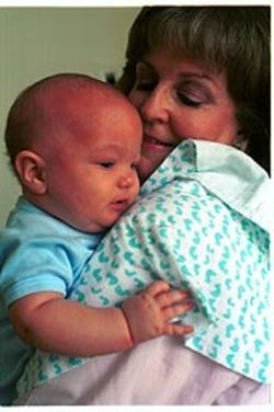 Little Devin Dunn, here with his mother, Diane, entered the world through the help of an egg donor. His parents, who live in Granbury, plan to tell him about his origins when he gets older.