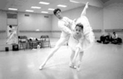 Maria Kudyakova and Mindaugas Bauszy of Ballet Arlington, rehearsing for The Nutcracker