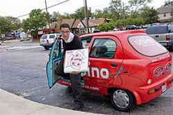 Owner/delivery driver David Pedack springs from his electric car—just one sign that Urbino cares.