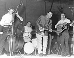 "Carl Perkins can be heard on The Big ""D"" Jamboree Live performing ""Blue Suede Shoes"" and ""That's All Right."""
