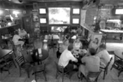 Raise your glass at the MAT to the great god of sports bars, the big-screen television.