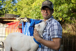 "When Andrew Howard, 34, moved from Lakewood to Oak Cliff, he didn't figure he would become a ""goat herder."" Now he cares for two charges, Clyde, pictured, and sister Bonnie."