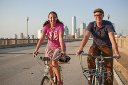 Pedaling over the Trinity,  Jason and Andrea Roberts head for Oak Cliff, where they've lived for the past 10 years, and where they have been instrumental in advocating for bike lanes and street fairs.