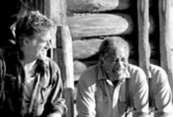 "Robert Redford and Morgan Freeman share a laugh in An Unfinished Life, probably over J.  Lo's ""Southern"" accent."