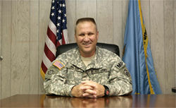 Army Colonel Bruce Vargo, commander of detention camps at Guantánamo Bay, sits in an office inside Camp Delta.