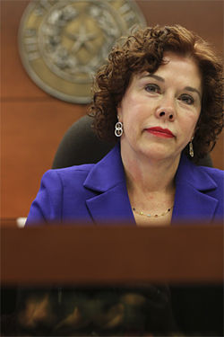 Dallas County family court Judge Lynn Cherry has been sparring with the Texas Attorney General's Office over whether or not a private firm can continue collecting payments for families.