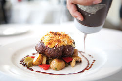 Standbys like the mac-and-cheese-crusted filet keep Hattie's dining room packed -- and keep suburbanites coming back to Oak Cliff.
