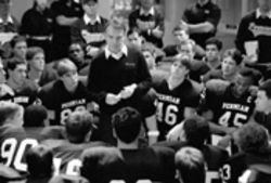Coach Gary Gaines (Billy Bob Thornton) gives a locker-room pep talk before a game in Friday Night Lights.