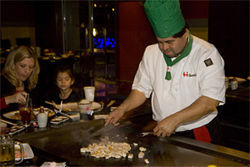 Some wins at this place, but mostly it's show: A chef entertains Hibashi Teppan's crowd.