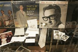 The Holly Grail: Buddy Holly's belongings, including his  passport and watch, brought hundreds of thousands at  auction this month.