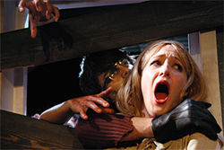 Mmmm, tastes like chicken: Barbara (Meridith Morton) is attacked by her brother-turned-zombie (Matt Savins).