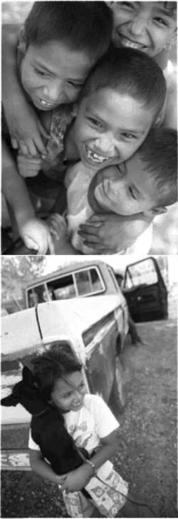 Top photo: Four children, from top to bottom, are Marylou, 12; Prudencio, 8; Salena, 7; and Pablo Martinez, 3. Bottom, puppy love: Joanna Castillo, 8, with dog Blackie outside her trailer home.