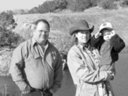 Cattle aren't stupid, says Texas rancher James Fuqua, with wife Lisa and son Reason.