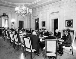 Ted Dealey, two seats to Kennedy's left, confronts the president at a White House luncheon.