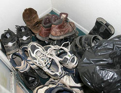 Kidnappers force illegal immigrants to remove their shoes to make it harder for them to escape.