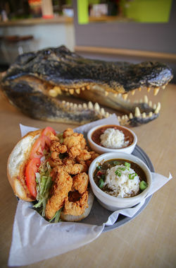 A gator po'boy is served with a side of serious Southern charm.