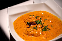 Although India West is a new restaurant, its owner and kitchen staff have served curry for more than 20 years.