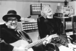 Elvis Costello and Anne Sofie von Otter laugh at Costello&#039;s latest hat during a break from the recording of For the Stars.