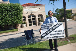 Muhammet Atayev stood outside Joseph Ashmore's law office for three months last fall, hoping to draw attention to Atayev's plight: He says a $250,000 investment was supposed to return $25 million in just three months. Instead, he says, he lost it all.