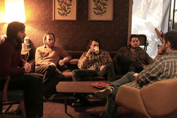 Midlake gathers for a chat on the couch that frontman Tim Smith slept upon for the first three months of recording.