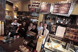 The afternoon shift at It's a Grind: a friendly coffee house to its patrons, a business model dedicated to reinventing the American workplace to its employees. From Left to Right: Marilynn King, Carlos Guerrero, Danae Bradley, Angela Brashere, Jo Chung, Stephen Barley