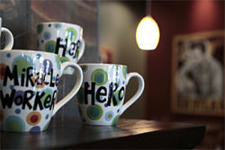 Inspirational coffee mugs are some of the non-caffeinated offerings for sale at It's a Grind.