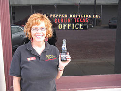 "Lori Dodd runs the Dublin Dr Pepper museum which sells official ""Dublin Dr Pepper Bootlegger"" T-shirts."