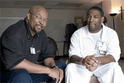 Michael Jarmon, left, is an IFI re-entry specialist responsible for inmates in the Dallas area. His job is to make sure each one has a job, a mentor, a place to live and a church upon release.