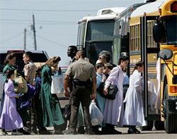 Children were bused to the San Angelo Coliseum with their mothers after the April 3 raid.
