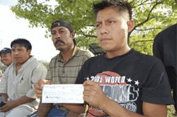 Anastasio and other workers tell of receiving a check they were unable to cash.