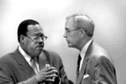 Council members Leo Chaney, left, and Gary Griffith retired to a corner of the chamber where they worked out a separate peace.